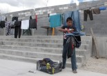 Brian Duran, 14, of Comayagua, Honduras, collects his line-dried laundry at the Senda de Vida migrant shelter in Reynosa, Mexico, June 3, 2014. Duran traveled alone to the U.S.-Mexico border and hopes to soon become one of the more than 47,000 unaccompanied children to enter the United States since Oct. 1, 2013. Credit: Associated Press.